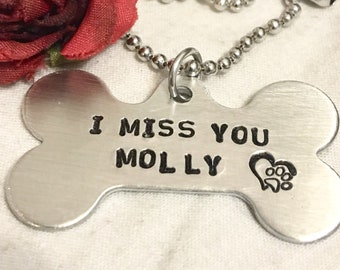 Dog bone memorial necklace, hand stamped with dogs name and I Miss You. Accented with a heart and paw. Memorial for fur baby. Rememberance
