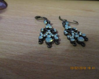 vintage dark brown metal dangling earrings with lots of sea green stones,clasp clips through in ear