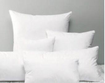 Cushion pad insert hollow fibre