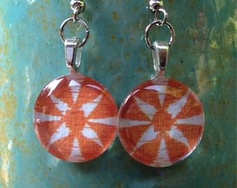 Charming circle glass tile in orange flower. 1/2 inch circle glass tile