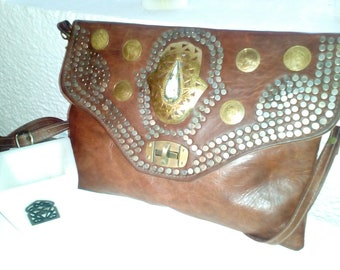 Handmade leather clutch  or shoulder bag  with farina hand on front
