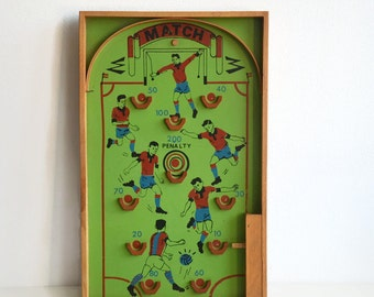 Vintage pinball game, marble game, football game from the 50's.
