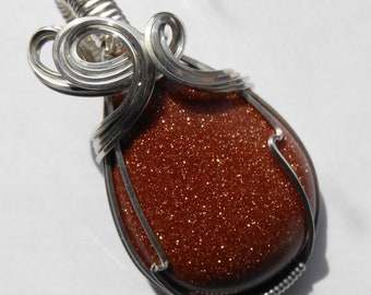 Sparkling Brown Goldstone Pendant Wrapped in Silver Filled Wire
