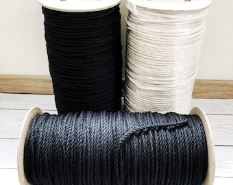 1000 ft (304 m) of cotton rope for macrame , diameter 6 mm, 3 ply, black or neutral .