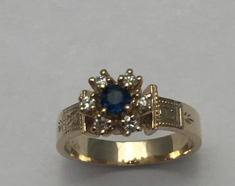 Style#163 14 Kt solid yellow Gold Sapphire and Diamond ring