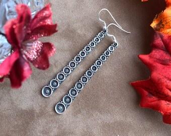 Long statement earrings