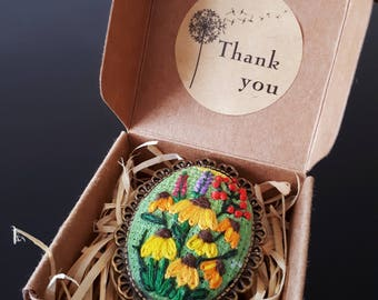 Embroidery brooch with sunflowers in antique frame