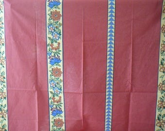 Original red background has polka dots and strips of 3 different designs, cotton fabric.