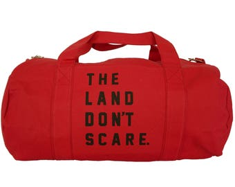 Red Duffel Bag with 'The Land Don't Scare' in Black Ink