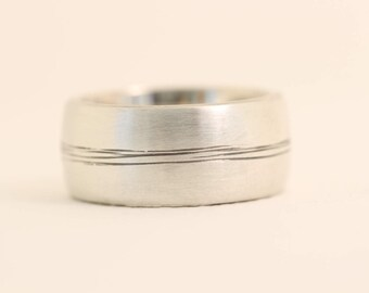 Bound Together in the middle recycled sterling silver mans wedding band.