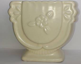 White urn planter