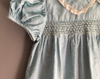 Vintage hand smocked toddler dress with delicate lace trim