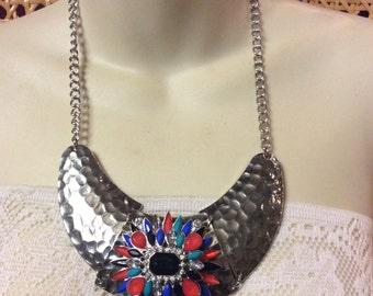 Vintage hammered silver metal rhinestone cluster necklace .