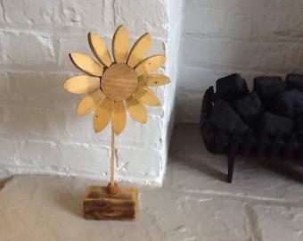 Sunflower in wood