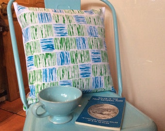 A beautiful hand-printed turquoise/green white cotton cushion cover complete with a feather-filled cushion.