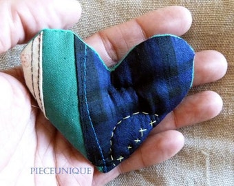 Textile patchwork brooch Heart shaped with yellow handstitched crosses Small