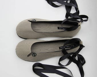 Raw fabric and leather sole slippers.