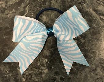 Small blue zebra striped cheer bow