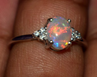 A Dazzling 6 x 8  MM Natural Ethiopian fire opal Gemstone Ring Fine Jewelry stunning set in sterling silver Size is ( US 7 ) 0066