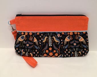 AK26- Compleat Clutch: in a fabulous bird print with pleated front, zipper closure and detatchable hand strap