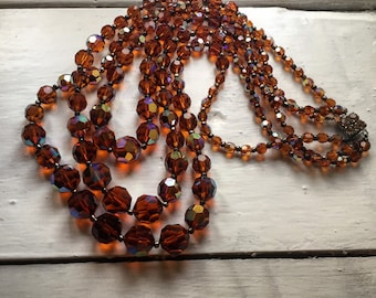 Beautiful three strand vintage amber faceted glass necklace