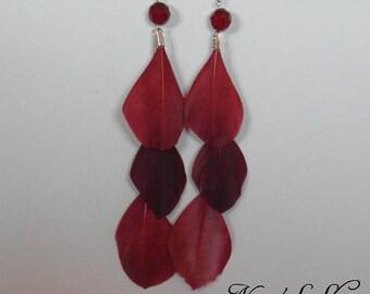 Long red earrings, feathers,