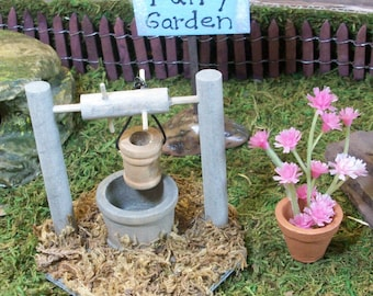 Fairy Garden wishing well with pink potted flowers