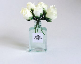 """5"""" Small white rose buds in a perfume vase"""