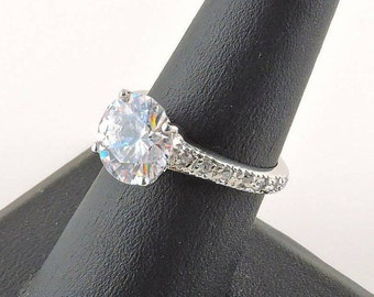 Size 7 Sterling Silver 4ct. Round Rhinestone Ring With A Rhinestone Encrusted Band