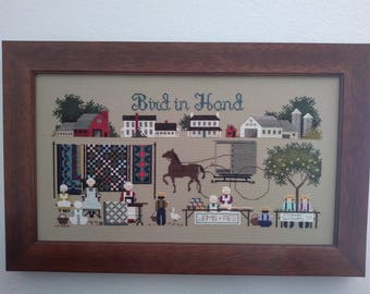 Bird in Hand finished, framed, counted cross stitch Told in a Garden