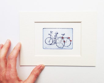 two bicycles, small original etching