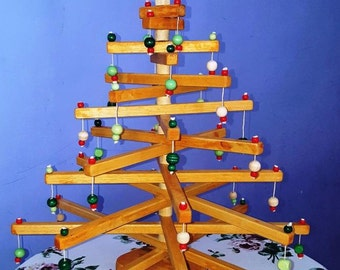 Wooden Christmas tree with colorful decorations. No need for assembly.