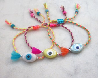 Evil eye bracelet, hippie cord friendship bracelet, colorful porcelain eye stack bracelet, neon boho tassel armband, braided cotton bracelet
