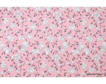 Tissu coton imprimé fleurs de magnolia rose .x1m
