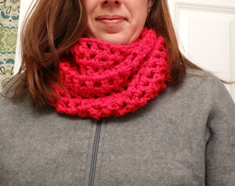 Bright red cowl neck scarf.