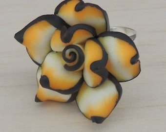Yellow and black polymer clay flower ring