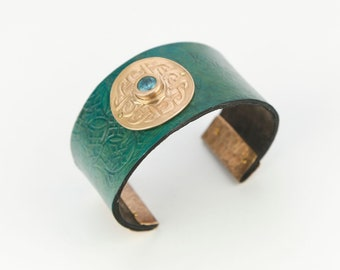 textured leather cuff/bronze component