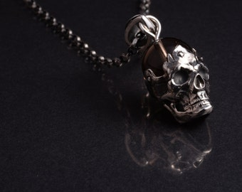 Sterling silver skull pendant and smokey quartz bead