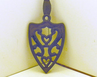 Black Cast Iron pot holder, two Heart pattern.