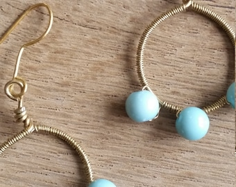 Gold hoop earrings with blue beads