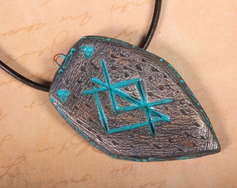 Norse Love rune on shield shaped clay pendant in turquoise and silver