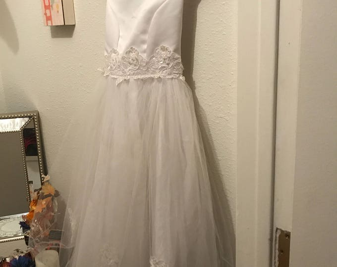 Beautiful hand-sewn white satin and tulle girl's formal dress