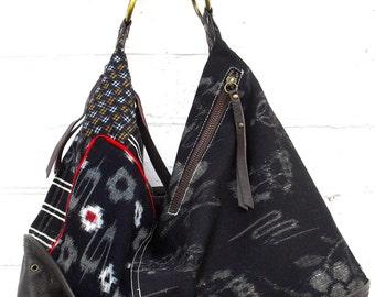 Japanese Indigo cotton  and leather handbag with a detachable strap.