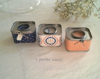 3 boxes in metal, cotton blends, baker twine tie. vintage vibe