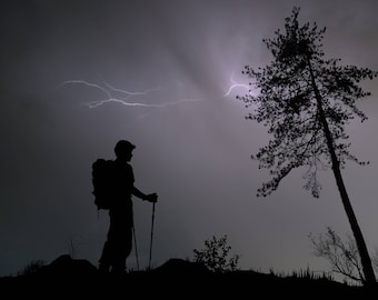Hiker of the Storm, Man Hiking in Thunderstorm on Mountain Ridge, Danger from the Storm, Lightning,, Storm Clouds and Rain, Tree Silhouettes
