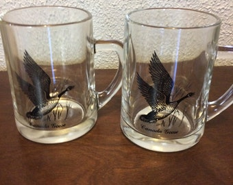 2 Vintage glass beer mugs/steins with a Canada Goose