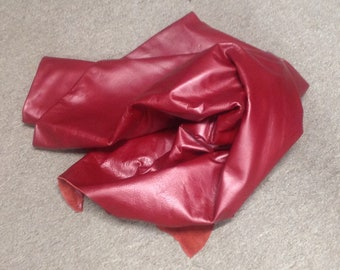 AB01.  Tomato Red Leather Cowhides