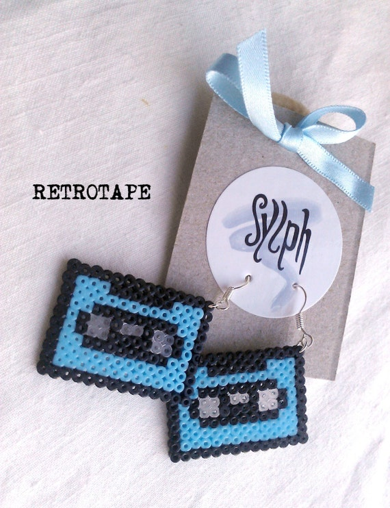 Pixelated baby blue Retrotape cassette earrings made of Hama Mini Beads made with love for pixel-perfect 8bit music lovers