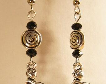 Monkey earrings with black glass beads