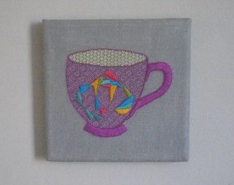Purple Spiro Teacup Wall Art. Hand Embroidery.